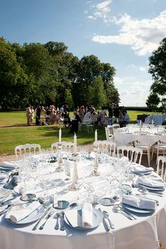 outdoor wedding : cocktail hour and tables set for dinner reception