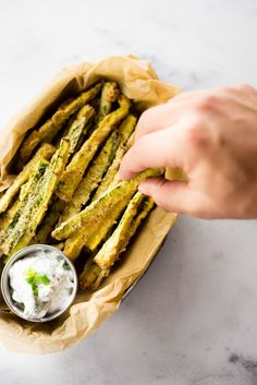 These addictive baked zucchini fries are a fun and healthy way to eat your veggies! Healthy Vegan Snacks, Healthy Baking, Vegetarian Recipes, Snack Recipes, Dinner Recipes, Cooking Recipes, Healthy Recipes, Baking Snacks, Veg Recipes