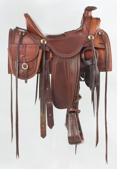 """Beautiful, custom half-seat Meier saddle used in the TV movie, """"Crossfire Trail"""" (2001), starring Tom Selleck and based on Louis L'Amour's 1954 book of the same name. Brian Lebel's Old West Auction, June 11, 2016. Est. $3,000-4,000."""