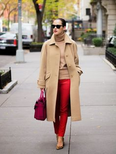 Red ankle pencil pants, camel turtleneck top & coat, pink handbag, leopard shoes.