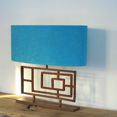 Table lamp redesigned from an Art deco balcony found in Lebanon. Rich turquoise Damask shade.