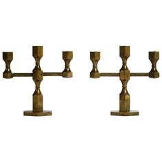 Lars Bergsten, Pair of Brass Gusum Table Candleholders, Sweden 1977 | From a unique collection of antique and modern candle holders at https://www.1stdibs.com/furniture/decorative-objects/candle-holders/