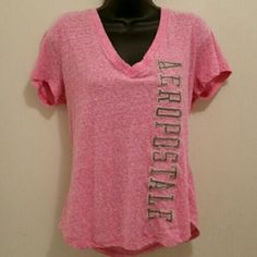 Pink Tee ((Bundle Item)) Cute blingy Aero tee! Rosey pink color with Aeropostal in gold glittery stitching! Worn once! Smoke free home!   ADD TO THE ITEM YOU LOVE FOR BUNDLING DISCOUNT!!! Aeropostale Tops Tees - Short Sleeve