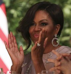 There it is! MIchelle Obama left her engagement ring at home in favor of a large cocktail ring - which almost completely concealed her wedding band - and diamond earrings - as she attended a state dinner in Argentina