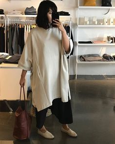 @_chicadeoro in our Place To Be Cape having a try on in @voyagershop San Francisco ♡ www.kowtowclothing.com #kowtow #kowtowclothing #organiccotton #mindfullymade #newseason #casestudykowtowclothing