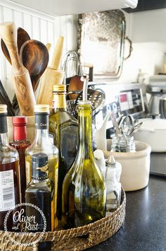 Spring colours in the dining room and kitchen - keep oils and vinegars in a basket on the counter!