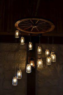 Make your own wagon wheel chandelier weddings pinterest wagon spiral wagon wheel mason jar chandelier large aloadofball Image collections