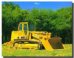 Enliven your place with this wonderful caterpillar truck loader equipment picture art print poster. This wonderful piece of art captures the image of yellow Caterpillar front wheel loader dozer truck looks amazing and sure to grab lot of attention. This front wheel loader dozer truck has traction mechanism like that of semi-rigid suspension car. It is a kind of most commonly used construction equipment in the construction site. It would a great gift for every truck lover.