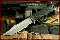 """SOG SEAL Pup - Partially Serrated. Total Length: 9"""" Blade Length: 4.75"""" Weight: 5.40oz. Blade Thickness: .19"""" Steel Type: AUS-8. Photo Credit: Zero7one."""