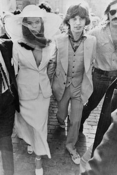 That plunging suit! Brazen & Chic. Just like Rock Stars oughta be.