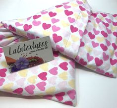 """Unique Gift. Heat therapy, 11 x 21 in. EXTRA LARGE microwavable flax heating pad, Organic Lavender, yellow and pink hearts, The """"Flax Sak"""" Hot/cold pack with removable/washable cover. A great pain reliever and bed warmer, this 11 x 21 in EXTRA large microwavable heating pad has a segmented muslin insert filled with food grade flax seeds and lavender buds. Its cover is removable and washable making it a hygienic product. It is also wonderful for using as a gentle cold pack. It is easy to…"""