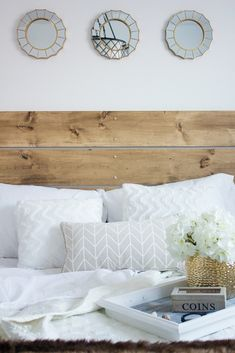 """Confession: I am obsessed with my new guest bedroom. Truly obsessed. I still catch myself walking by, peeking in, and giggling like an excited little school girl. Like, pinch me, this room is in my house! The planning process for this room was a long time coming. I have lusted over white rooms forever, but never considered myself """"bold"""" enough to pull it off in my own home. Once I came to the conclusion that this room had to be white, everything else sort of fell into place. Warm, rustic…"""