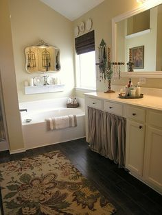 Interesting- mirror & storage on that back wall. Reminds me of your bathroom @Devon Evans