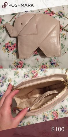 Authentic Kate Spade Origami Elephant Bag/Clutch An adorable statement handbag by Kate Spade that was available around 2015. It's in great condition as I only used it once or twice. It has a detachable chain so it can be used as a shoulder bag or as a clutch. kate spade Bags Crossbody Bags