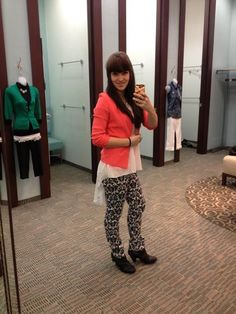 Heres these printed pants again. Jackie really makes them work with the high low top and pink blazer <3