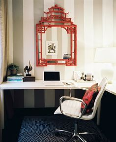 A red chinoiserie mirror hung on striped walls above a white desk. Via Lonny Magazine. Designer Anna Burke. Walls: Lines & Stripes