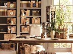 Mocha colored bookshelves w natural baskets with numbered tags.