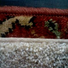 Make an inexpensive holiday themed area rug by binding or serging a carpet remnant.