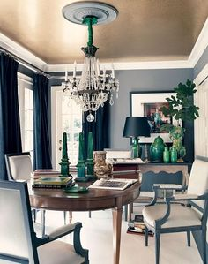 touches of dark teal in the curtains and furniture - and a gold ceiling - unique!