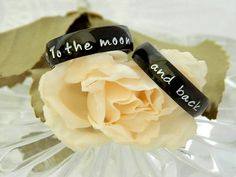 Couples Matching Hand Stamped Name Ring, Set of 2 Black Stainless Steel Rings, Promise Rings, BLACK Stainless Steel Comfort Fit by SnowMountainDesigns on Etsy https://www.etsy.com/listing/105676338/couples-matching-hand-stamped-name-ring