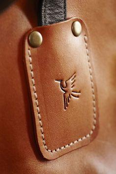 Portfolio - The Traditional English Apron Company making wonderful use of their crane stamp. Leather Apron, Leather Label, Leather Stamps, Laser Engraving, Sunglasses Case, Artisan, Traditional, Crane, Badge