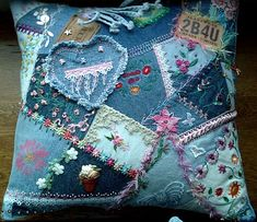 I ❤ crazy quilting & embroidery . . .  The two leather labels were added strategically to cover holes in my piecing as was the frayed denim heart I made & added. My talented friends added beautiful Brazilian embroidery during the round robin phase - a special thanks to Shari for her talents here! With the denim it was possible to add some larger braids, beads, etc. that I wouldn't ordinarily use on cq and combining them with the fine embroidery made the whole piece fun. ~By kerrykatiecakes