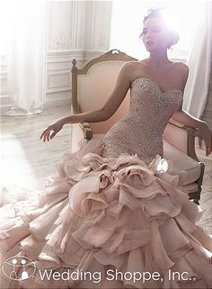 Dramatic fit and flare bridal gown in blush.