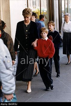 Diana with Prince William and Prince Harry.  They are followed by their nanny, Olga Powell.