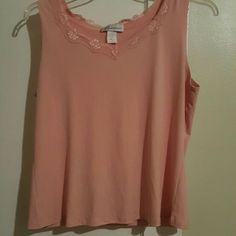 Peachy Pink Camisole This silky peach cami us great for layering up under a shirt or jacket. Dainty lace accent on the neck and straps! Dress Barn Tops Camisoles