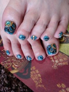 Pretty pedicure: Very intricate (and beautiful!) design resembling a Peacock feather theme with jewels. This would take time and a steady hand, but the result is just stunning! LOVE IT!!