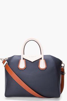 64e115946ead Black Medium Givenchy Antigona Tote Bag with contrasting color strap handle.