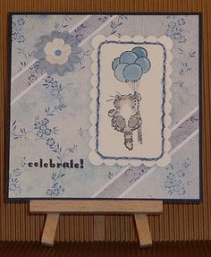 With sweet paper and soft colouring (grey cat and balloons shades of blue) Penny Black critter is perfect for an elegant card :)