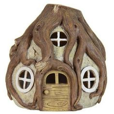 Solar Tree Root House. www.teeliesfairygarden.com . . .  This tree root house will capture the attention of your fairies, because these roots catches light from the sun. Having the dark of the night appear like day-magical! #fairyhouse