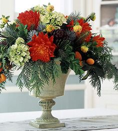 Evergreen and Flower Centerpiece.          This centerpiece lives large with relatively few flowers. Create a base of evergreens, such as cedar and noble fir, then fill in with large flowers (such as hydrangeas and mums).