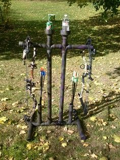 His and her bow stand made out if PVC pipes. Complete with cup holders.