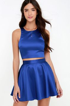 """Start your day, and kick off your night with the cutest combo around ... the Set for Success Royal Blue Two-Piece Dress! Luxe satin creates a sleek look across a sleeveless crop top with flattering side darting. A high-waisted skirt completes this winning duo with its full and flaring silhouette. Top and skirt have exposed silver back zippers with claps.  Small top measures 15"""" long. Small bottom measures 16.5"""" long."""