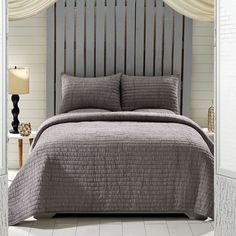"""Grey Includes: 1 Hand-quilted Quilt (86x68) 1 Standard Hand-quilted Shams (21x27) Single fabric; Hand quilted, machine stitched; Overall ruching with 2"""" horizontal line hand quilting; Ruching creates"""