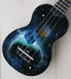 Beginners black mahalo soprano ukulele with nylon strings, hand painted in acrylic on front and back with a doctor who themed design featuring a police Cool Ukulele, Bass Ukulele, Cool Guitar, Banjo, Doctor Who, Guitar Painting, Guitar Art, Marceline, Painted Ukulele