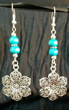Wooden turquoise with silver flowers