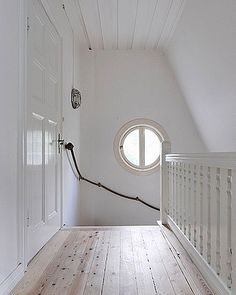 Subtle nautical stairs and landing - white washed wood panels, porthole window and navy rope handrail Rope Railing, Banisters, Rope Decor, Interiores Design, Stairways, Decoration, Home Projects, Interior Inspiration, Interior Decorating