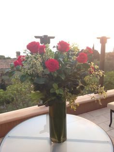 """Thank you for sharing your favorite #pelicanhill #memory with us, Delaney! """"It was hard to choose between this photo or the one of our Parmesan risotto from Andrea, but there is truly no better view than long stem red roses overlooking the ocean with my love."""""""