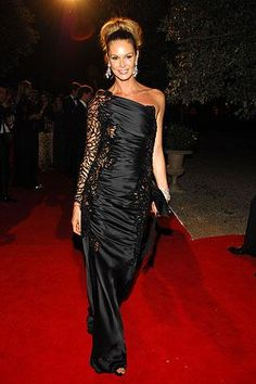 Who made Elle Macpherson's black long one shoulder dress? Dress – Valentino