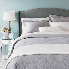 Gray, white and aqua bedroom.