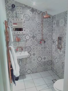 Wet room, underfloor heating, patterned tiles, copper shower, copper taps, copper radiator