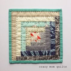 Log Cabin block... especially like the big stitch quilting