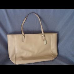 """Pre-owned Coach tote bag COACH Saffiano leather Large East/West tote. Light tan. Top zip closure. interior cell phone and multi-function compartments.  Gold feet. Metallic-foil embossed logo.  Fabric interior shows light to moderate stains no rips/tears pls see pics. Coach hang tag attached. This is a very durable & roomy multi-use bag. The upper length of bag is 21"""". Coach Bags"""