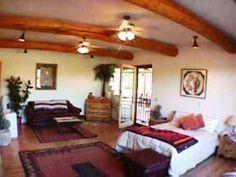 Southwest Bedroom Uses Santa Fe Style Decor. Ceiling Has Dry Hand Peeled  Wood Vigas Poles
