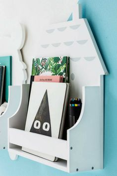 I love this adorable decorative and fun children's wooden house shelf. It's the perfect addition to a nursery or child's bedroom. This house shaped themed shelving unit is a lovely way to hold and display books, plush toys, trinkets, pencils and more in a kid's room. #ad #kidsroom #shelf #house #houseshelf #homedecor #nurseryroom #childrensroom #roomdecor
