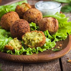 This crunchy middle-eastern snack is made with chickpeas and flavored with spices. Serve with hummus, baba ganoush and pita bread. Indian Food Recipes, Vegan Recipes, Ethnic Recipes, Falafel Salad, Falafels, Vegetarian Lunch, Canned Chickpeas, Recipe Details, Going Vegan
