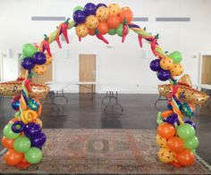 #Balloon #fiesta theme arch for a school book fair. Even with kids whacking at it for days, it held up strong.  www.spiralspiritballooncompany.com